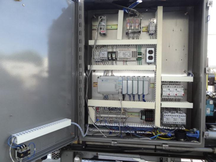 Used Hartness 900AT Case Packer Drop Packer full