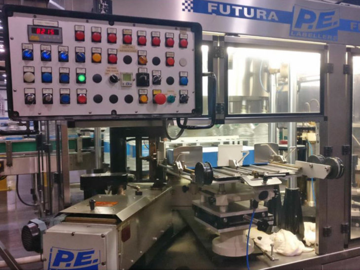 Used P.E. LABELLERS Rotary Cut & Stack Hot Melt Glue Labeler full