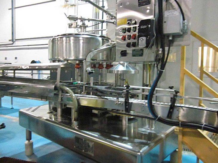 Used Filler Specialties 18 Valve Gallon Jug Filler with Capper full