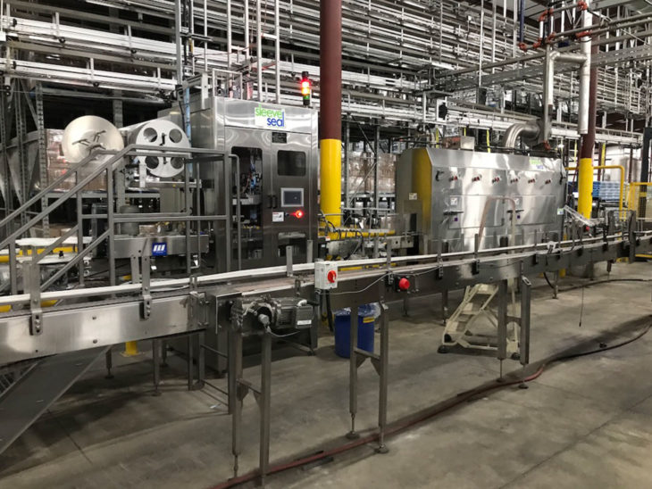 Used High Speed Sleeve Labeler with Steam Tunnel
