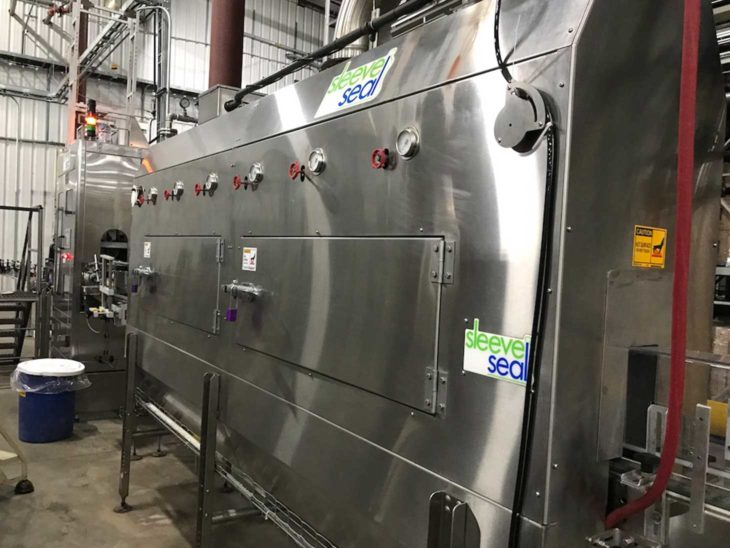 Used High Speed Sleeve Labeler with Steam Tunnel full