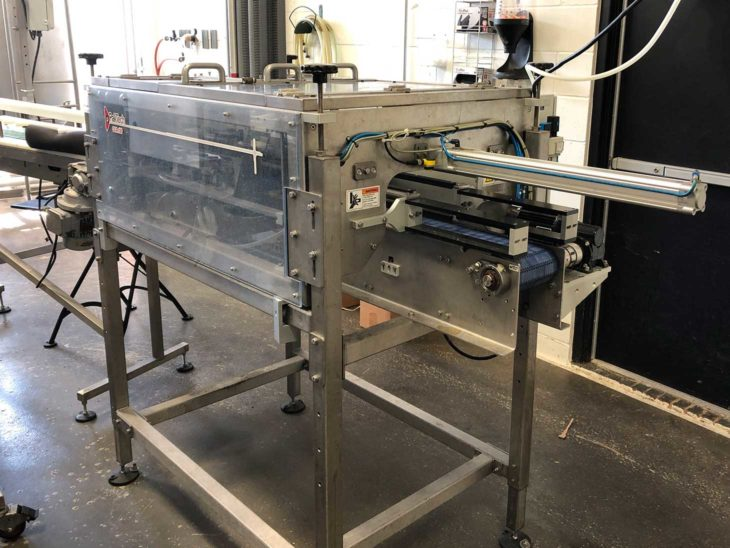 Used PakTech Can Carrier Applicator